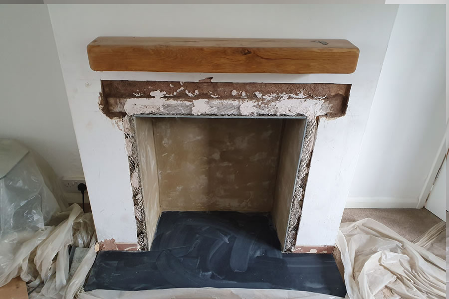 Fireplace renovation after knockout but before plastering