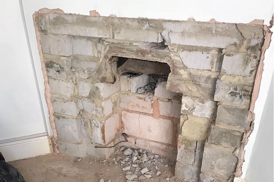After removal of stone surround, requires rebuild to strengthen