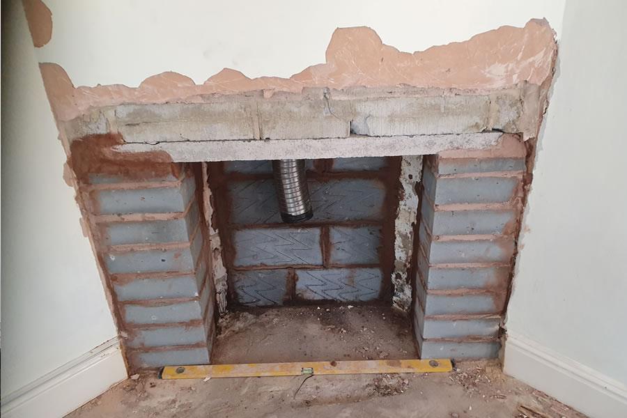 Rebuilt fireplace in blockwork ready for rendering