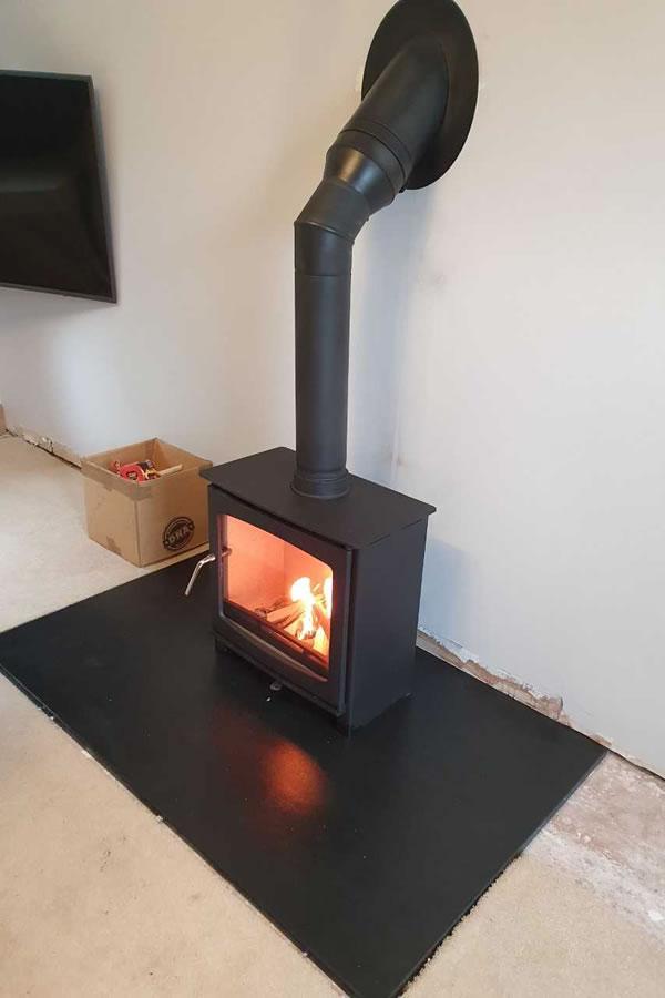 woodburner installer using twinwall chimney systems Cotford St Luke