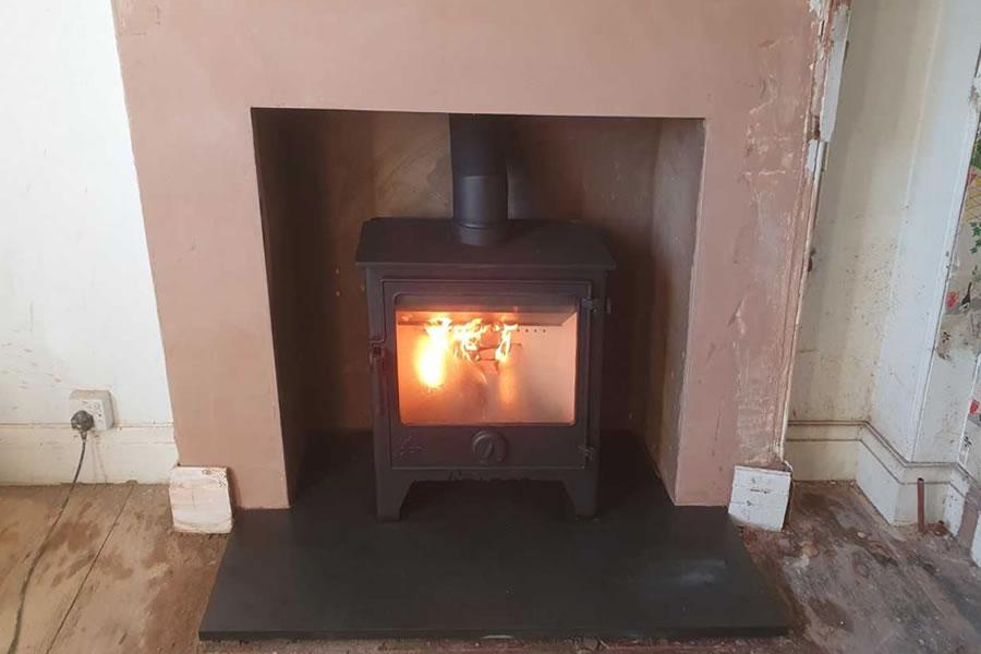 Completed fireplace enlargement woodburner installation Glastonbury
