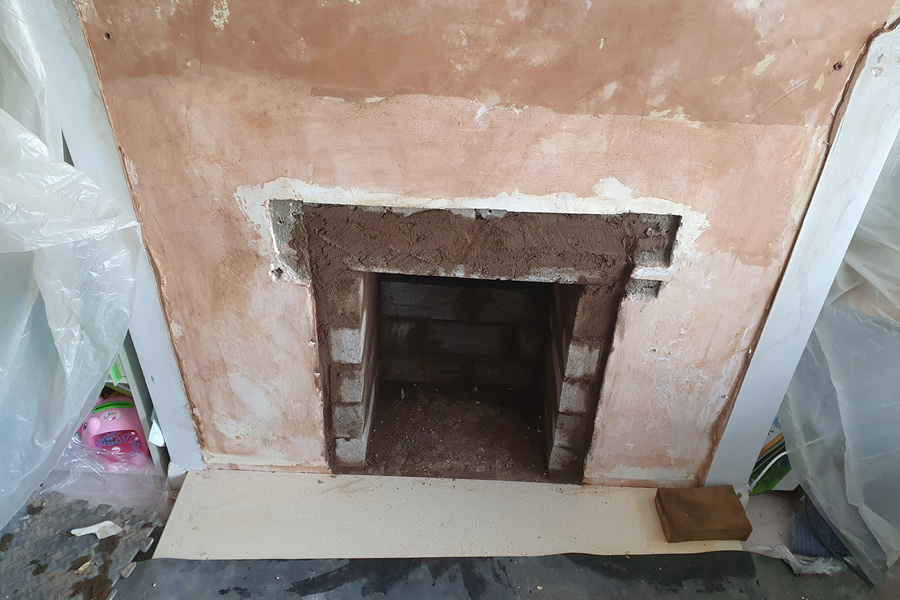 Building work to reduce size of fireplace recess