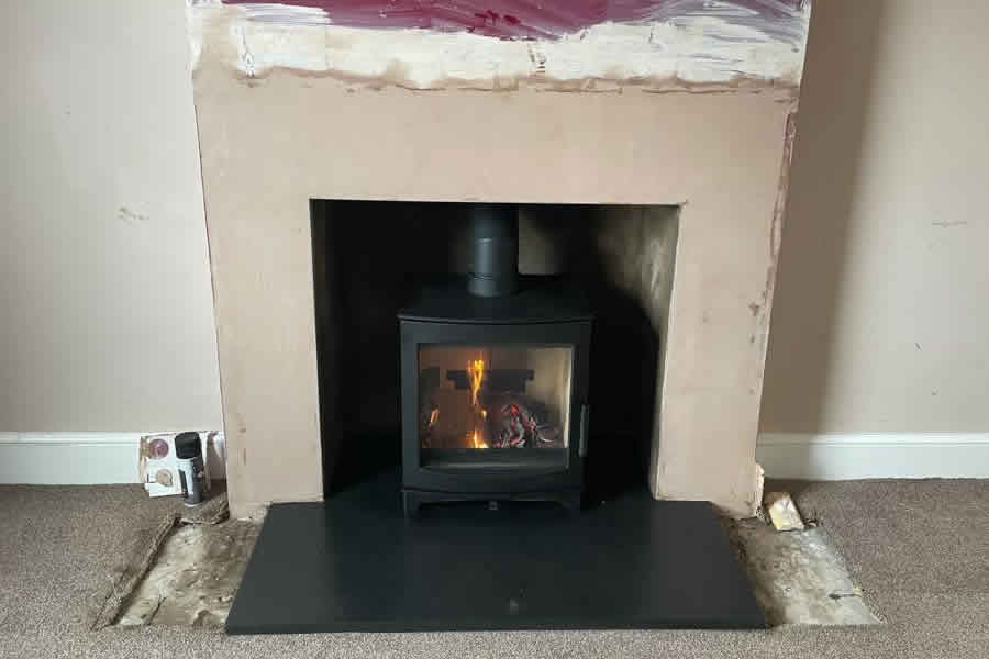 Completed fireplace renovation and woodburner installation